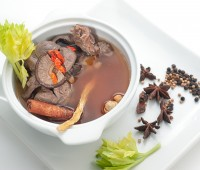 Traditional oriental beef broth with mushrooms